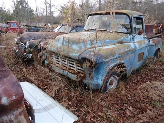 1956 Chevy pickup truck in field