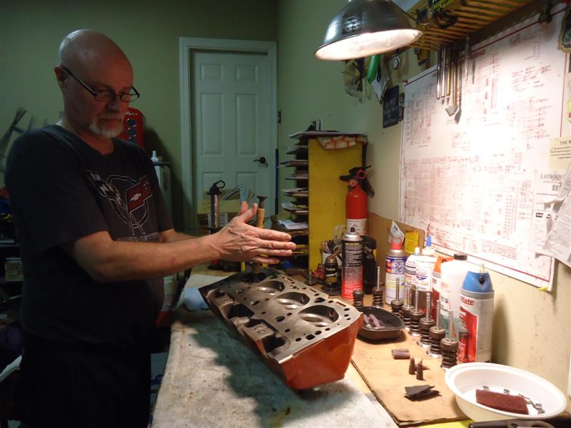 author Mark Trotta rebuilding small block Chevy head