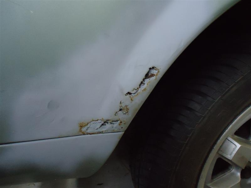 rust repair on quarter panel